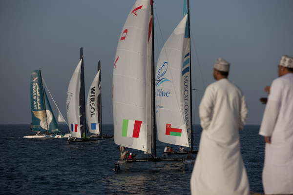 Extreme Sailing Series 2011 - ACT 1 - Muscat - The fleet racing close to the shore - © Lloyd Images
