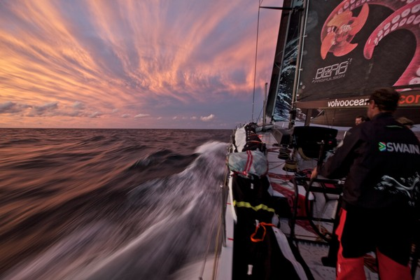 Jonathan Swain driving towards a brilliant post-frontal sunset. PUMA Ocean Racing powered by BERG during leg 5 of the Volvo Ocean Race 2011-12, from Auckland, New Zealand, to Itajai, Brazil. (Credit: Amory Ross/PUMA Ocean Racing/Volvo Ocean Race)