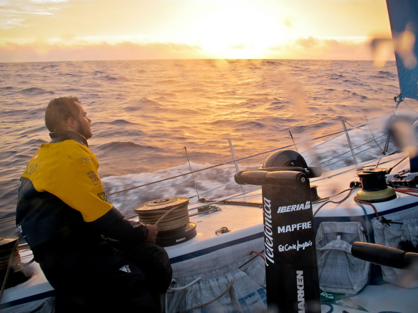 Pablo Arrarte at the trim looking at the sunrise onboard Team Telefonica during leg 5 of the Volvo Ocean Race 2011-12, from Auckland, New Zealand to Itajai, Brazil. (Credit: Diego Fructuoso/Team Telefonica/Volvo Ocean Race)