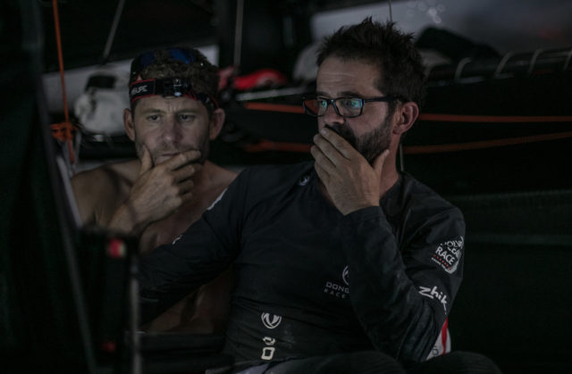 Leg 02, Lisbon to Cape Town, day 13, on board Dongfeng. Reactions to the 1pm sched that just came in. Pascal and Charles are wondering about their next step. Photo by Jeremie Lecaudey/Volvo Ocean Race. 17 November, 2017.