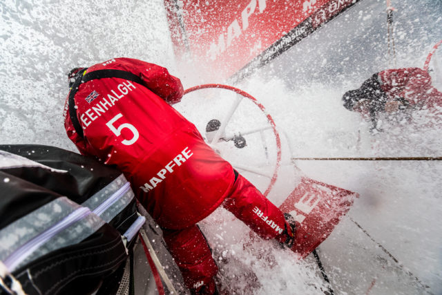 Leg 6 to Auckland, day 05 on board MAPFRE, sailing with 30 knots, Rob Greenhalgh at the helm, Louis Sinclair at the aft pedestal. There is no place to hide yourself and avoid the constant water on deck. 11 February, 2018 - - © Ugo Fonolla/Volvo Ocean Race